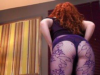 Red haired grown up woman Amy C is masturbating her drained hairy twat